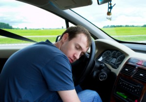 Man sleeping on steering wheel