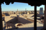 The Kalta Minor minaret (Guyok Minar / Green Minaret) is visible in the right in Itchan Kala, which is the walled inner town of the city of Khiva, in Khorezm Province, Uzbekistan, and is a UNESCO World Heritage Site.