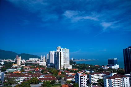 Beachside condos currently listed in an area called Batu Ferringhi in Penang . The condo has three bedrooms and has 1,400-square-foot of living space. Price: $196,144. It's a 10-minute walk to the beach, and all the condos have sea and/or jungle views. ©Ronen; Fotolia.com.