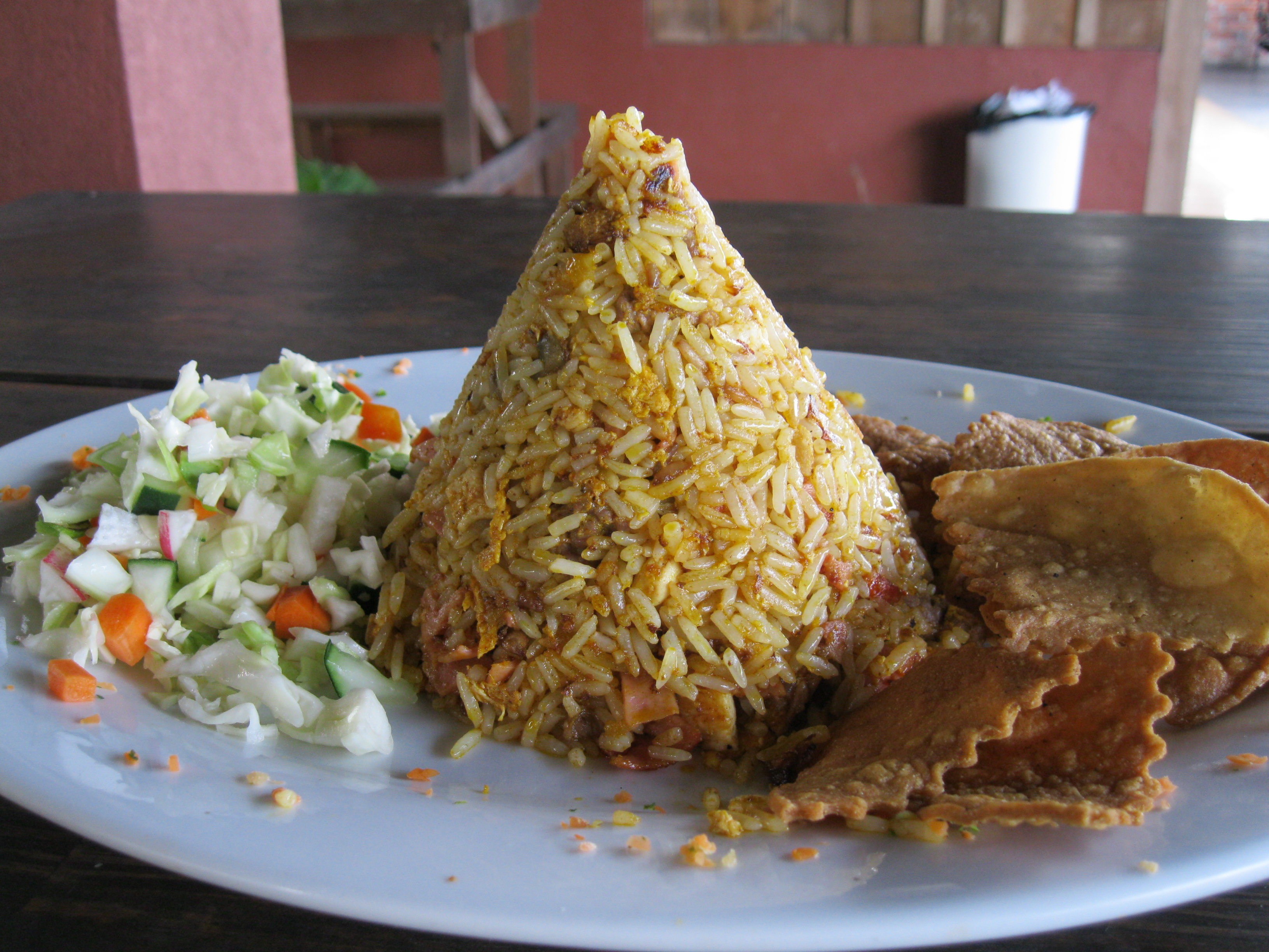 Although American-style food is becoming popular, traditional Costa Rican food remains the meal of choice for most Costa Ricans. This is chicken with rice, with a side of cabbage salad, a staple dish.