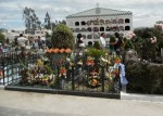 The mestizo side of this Ecuadorian cemetery is more ornately decorated than the indigenous side, for the Day of the Dead celebration.