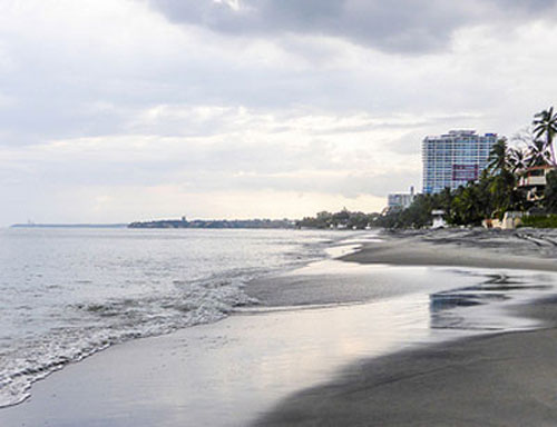 The beach—a mix of bright white and glittering black volcanic sand—goes on for miles. Most of the time, you can have big stretches of it all to yourself.