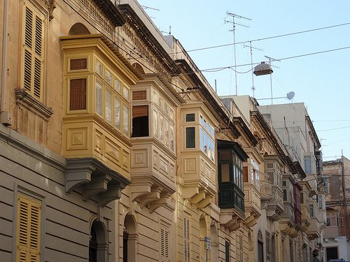 Sliema is one of Malta's busiest shopping areas—there's even a mall. But walk just a short distance from the main streets and you find quiet residential neighborhoods. Neo-classical buildings, with lovely windows at the upper stories, provide comfortable living space.