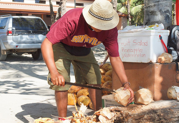 Santa Teresa has become a haven for beach-lovers from around the world. Beach bars, hotels, and restaurants—all small operations run by Ticos or expats—line the shore. Here a local entrepreneur sells ice cold coconut water—very refreshing on a hot day.