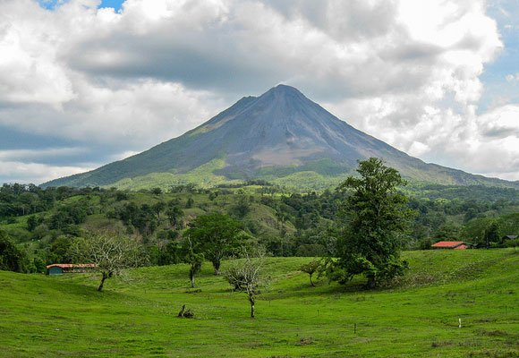 At the east end of Lake Arenal there is the 5,479-foot cone-shaped volcano that is active but not dangerous.