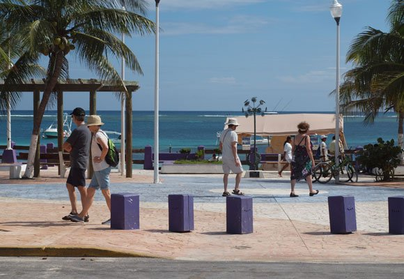 The small malecon, or boardwalk, is a place to sit and watch the water. You can meet friends for a day at the beach or lunch at the restaurants that line the waterfront.
