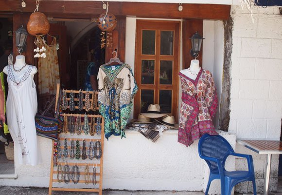 The central park in the middle of town is lined by small shops selling handicrafts and souvenirs.