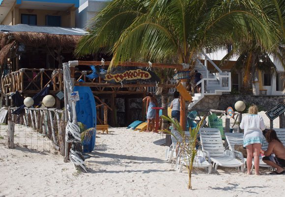 Beach bars in Puerto Morelos draw tourists, as well as expats for fun in the sun.