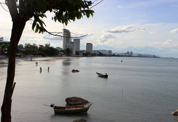 Fishing boats in Khao Takiab bay and Hua Hin condos in the background show the merging of the old with the new in this beautiful coastal area of Thailand.