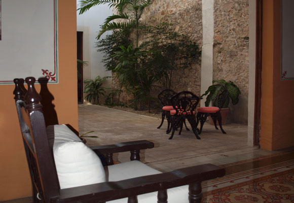 The interior of many of the homes in Mérida are colonial like this home, with open air courtyard.