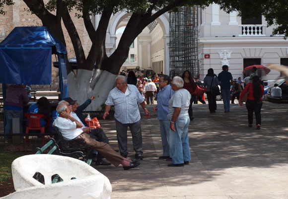 Friends chat in the Plaza Grande in the center of town. The surrounding streets are closed to traffic on Sundays.
