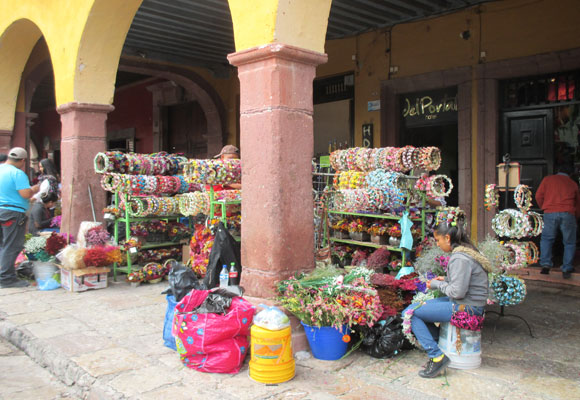 Vendors selling traditional crafts take up position in the colonnades around El Jardin Principal, the main park in town.