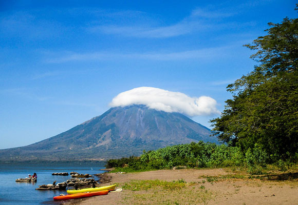 The Maderas volcano, which is dormant and stands at a height of 4,573 feet, rises above one of Ometepe's many beaches.