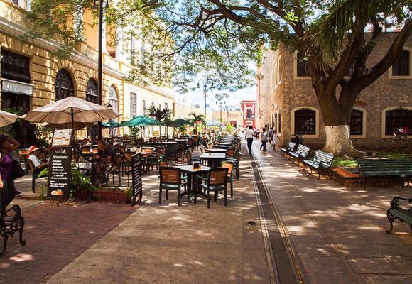 Enjoy a coffee at a sidewalk café in Merida, on Mexico's Yucatán Peninsula.