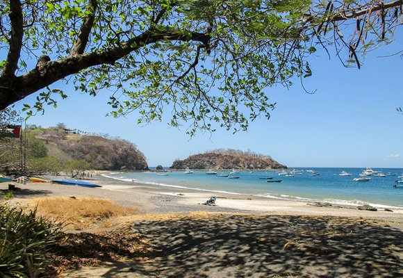Locals enjoy soaking up Playa Ocotal's tranquil atmosphere whilst sitting in the shade of one of its many trees.