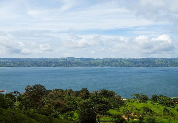 Surrounded by luscious green farmland, Lake Arenal offers expats some of Costa Rica's best views.