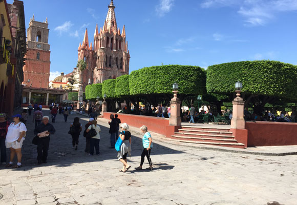 In San Miguel de Allende, the main plaza is called El Jardin. The pink stone, neo-Gothic bell tower, La Parroquia, is a symbol of the city.