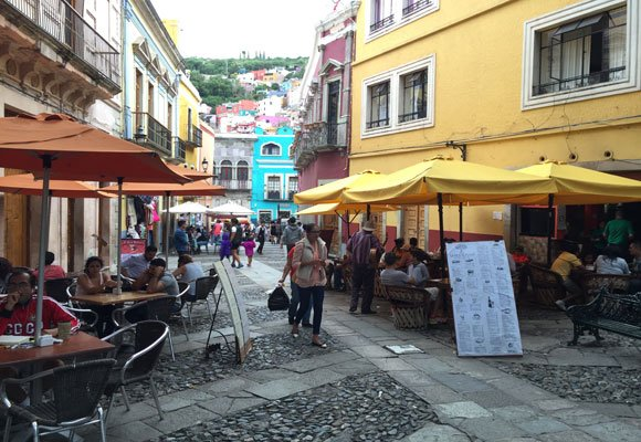Brightly-colored buildings abound in Guanajuato, as do sidewalk cafés and restaurants.