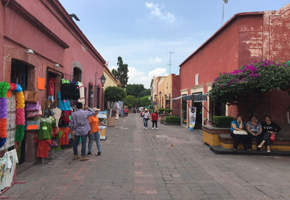 A narrow shopping street in Querétaro is popular with locals, as well as tourists, most of whom are Mexican.