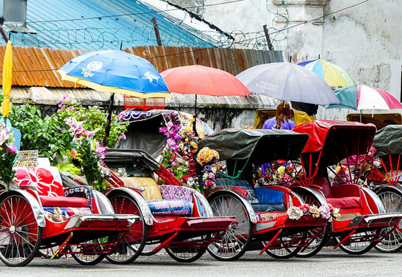 Grabbing a ride on a famous tuk tuk in George Town is a must-have experience. Relax and enjoy as your guide takes you through this vibrant Asian city.