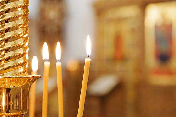 Light a Candle at the Church of Agioi Konstantinos and Eleni