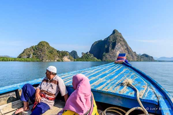 Passengers on a public longtail boat from Ko Yao Noi to Phang Nga
